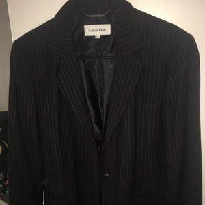 Black pinstripes blazer by Calvin Klein